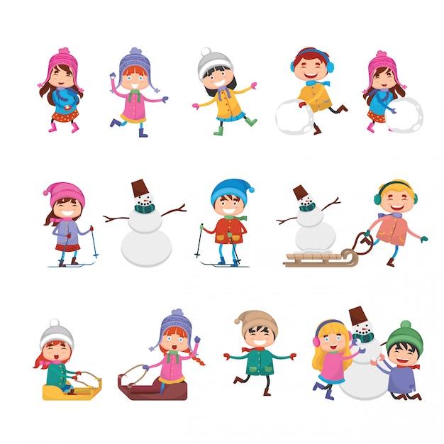 冬で遊ぶかわいい漫画の子供たちのグループ Premiumベクター