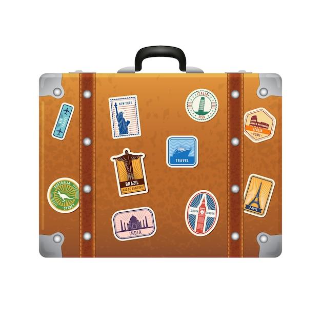 レトロな革のスーツケースにステッカーを旅行します。ベクトルラベルセット Premiumベクター