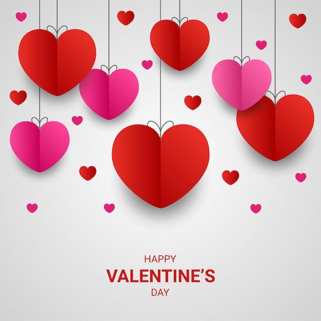 幸せなバレンタインデーの紙は、白でカラフルなハート形のスタイルをカット Premiumベクター