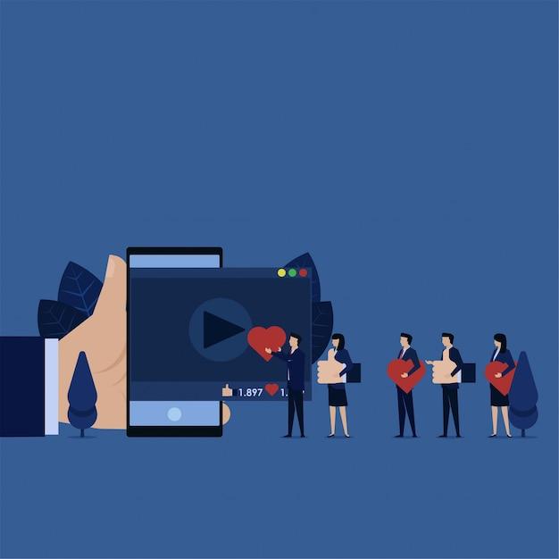 Бизнес-команда дает большой палец и любовь к рейтингу видео. Premium векторы
