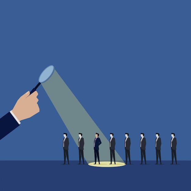拡大と手は、労働者を雇うための従業員を選択します。 Premiumベクター