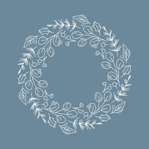 花とコーンの枝とのクリスマスリース Premiumベクター