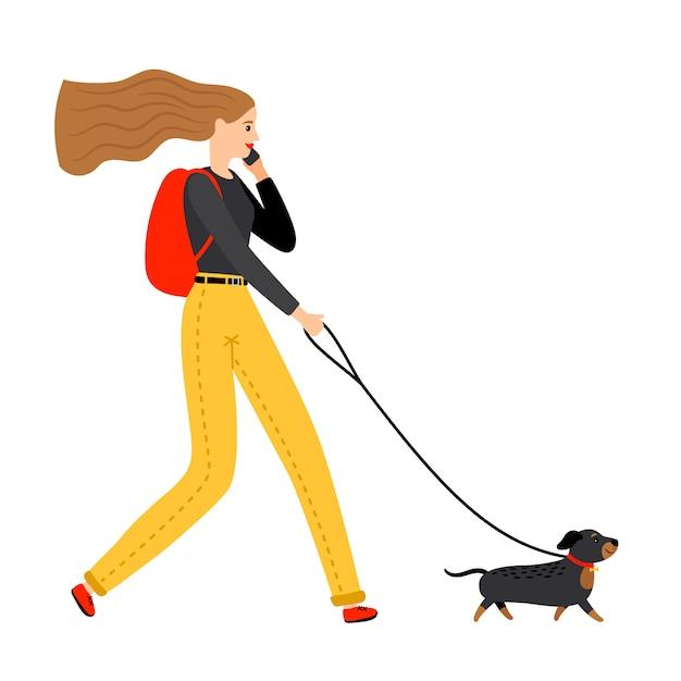 犬と一緒に歩いている女性 Premiumベクター