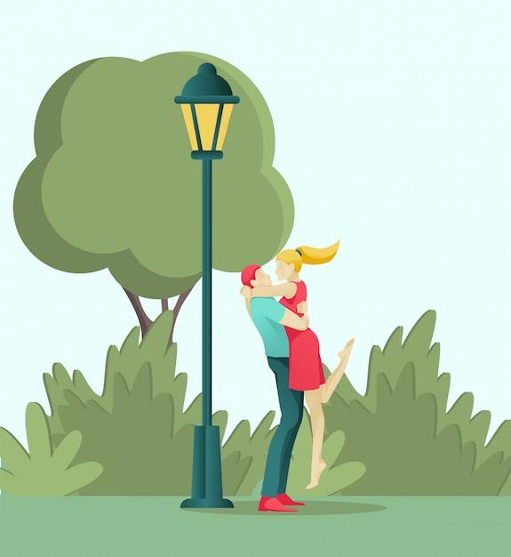 Молодая влюбленная пара целуется и обнимается в парке Premium векторы
