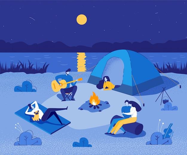 キャンプファイヤーの周りに座って休憩している人々。 Premiumベクター