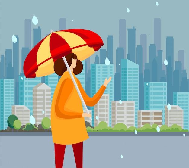 雨のキャッチに立っているマントの若い女性が値下がりしました。 Premiumベクター