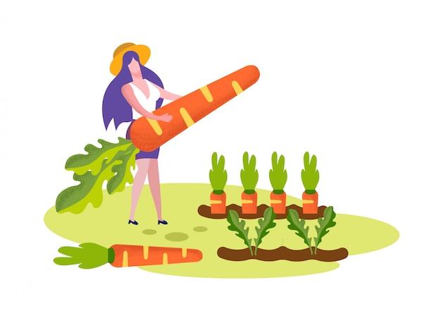 若い女性は庭のベッドに巨大なニンジンスタンドを保持します。 Premiumベクター