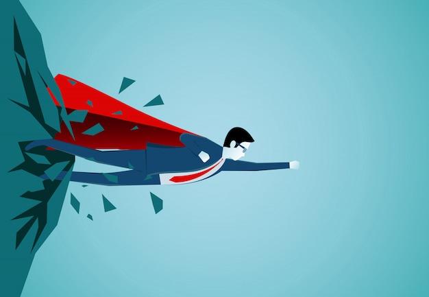 岩の上から飛び出しているスーパーヒーローのビジネスマンは空に飛び立っています Premiumベクター