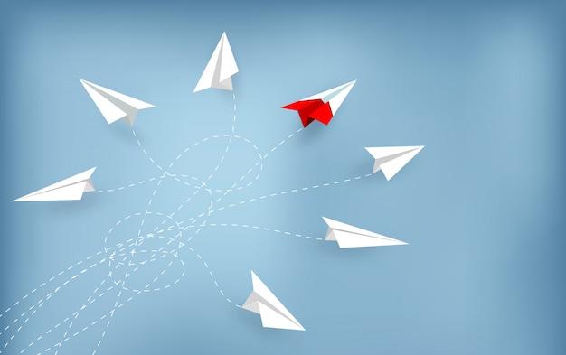 赤い紙飛行機が白から方向を変える。新しい考え。 Premiumベクター