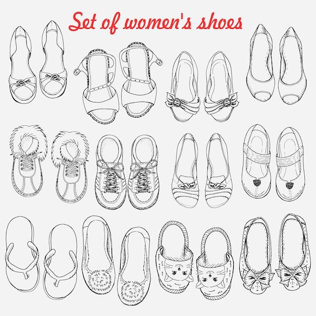 白い背景の上の女性靴のセット Premiumベクター