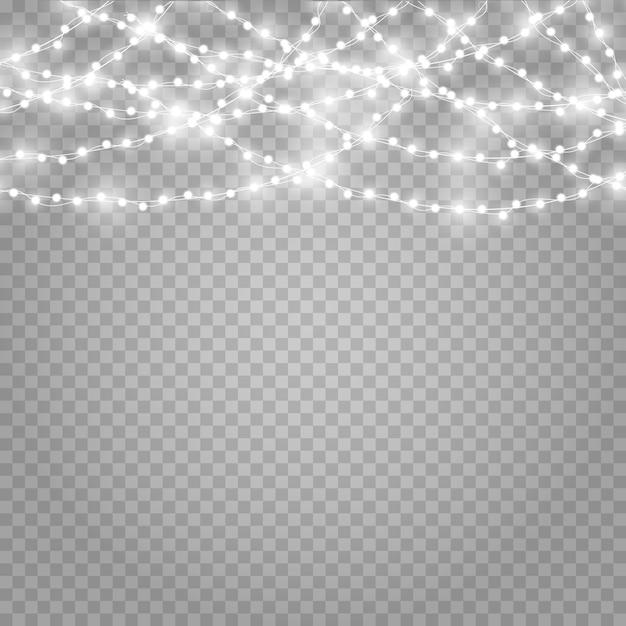 Рождественские огни на красивый прозрачный фон. Premium векторы