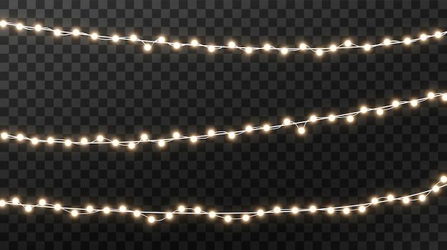 Светящиеся огни на рождество, гирлянды украшения Premium векторы