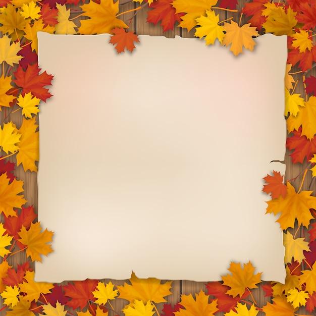 Старый лист бумаги в опавшей листве клена Premium векторы