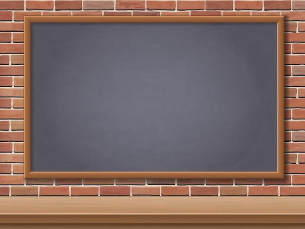学校の黒板とレンガ壁の背景の机。学校に戻るはがきのテンプレートの背景。 Premiumベクター