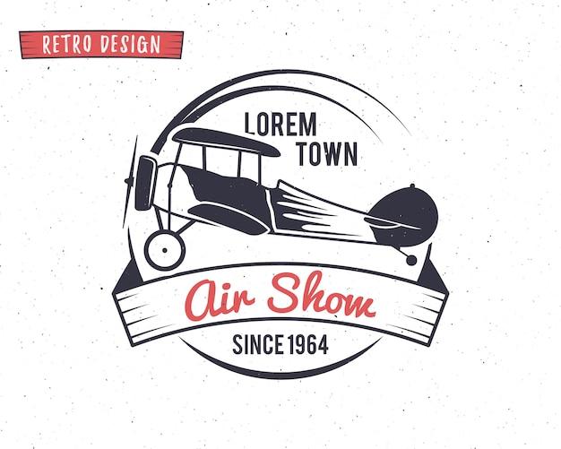Ретро дизайн логотипа с самолетом на авиашоу Premium векторы