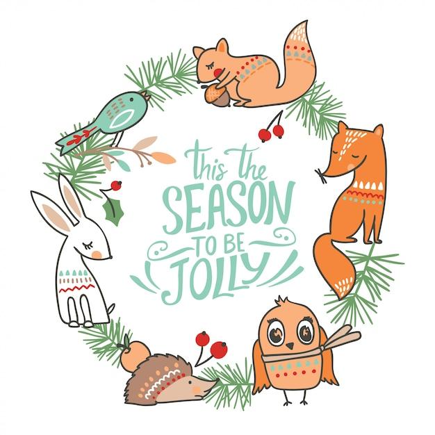 Зимняя рождественская открытка с животными Premium векторы