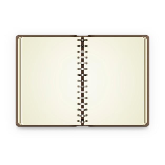 空白のページでノートブックを開く Premiumベクター