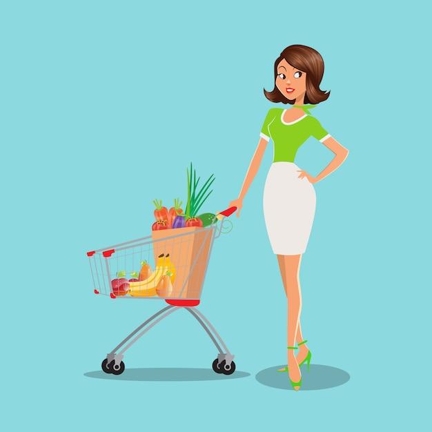 スーパーマーケットで果物や野菜がいっぱい入ったショッピングカートを持つ若い女性。 Premiumベクター