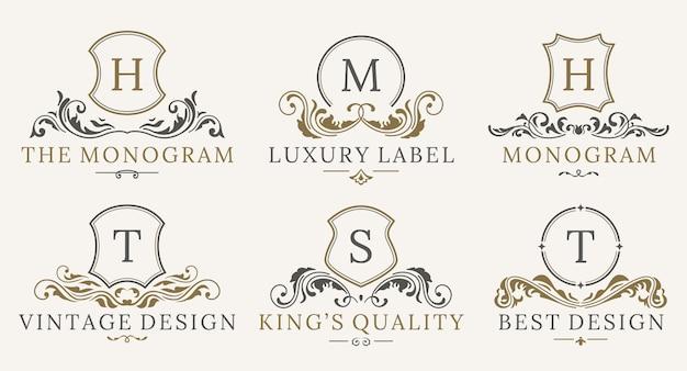 Ретро королевский винтаж шилдс логотип набор. векторная каллиграфия роскошные элементы дизайна логотипа. Premium векторы