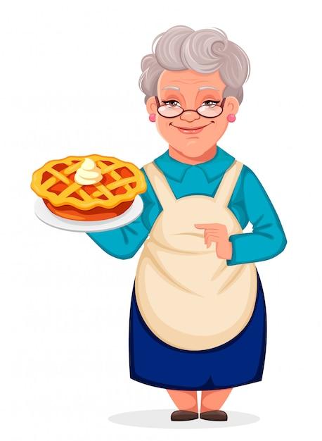 おいしいカボチャケーキを保持している祖母 Premiumベクター