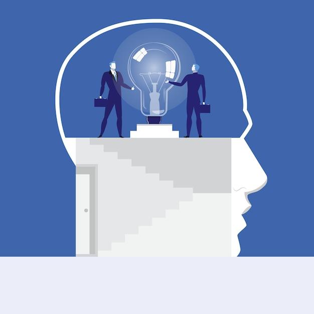 Векторная иллюстрация бизнесменов, держась за идею лампы Premium векторы