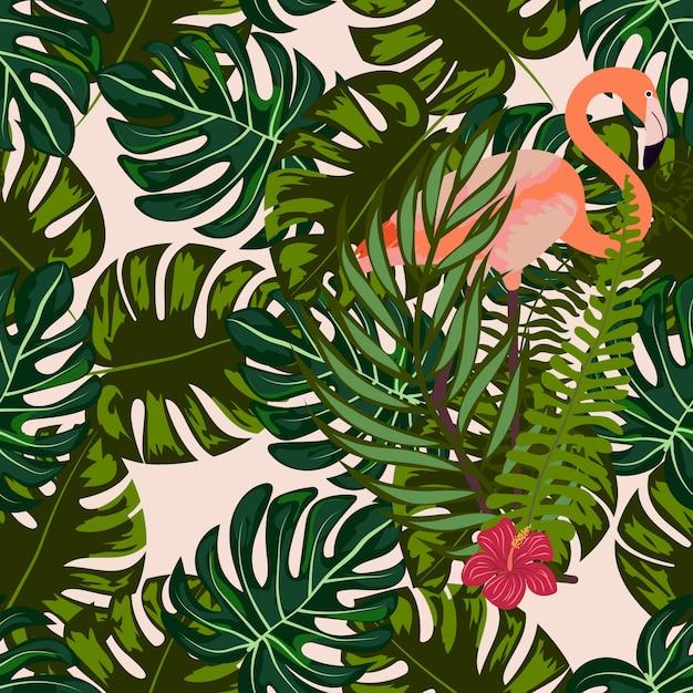 熱帯の花と葉のシームレスパターンを持つフラミンゴ。 Premiumベクター