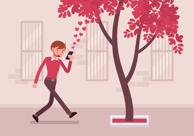 男は木にぶつかるためにスマートフォンで歩く Premiumベクター