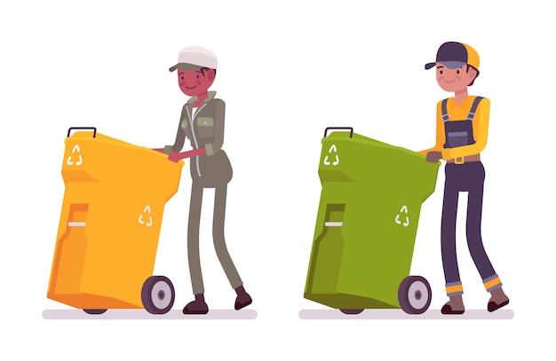 ユニフォームプッシュゴミ箱の男性と女性の廃棄物コレクター Premiumベクター