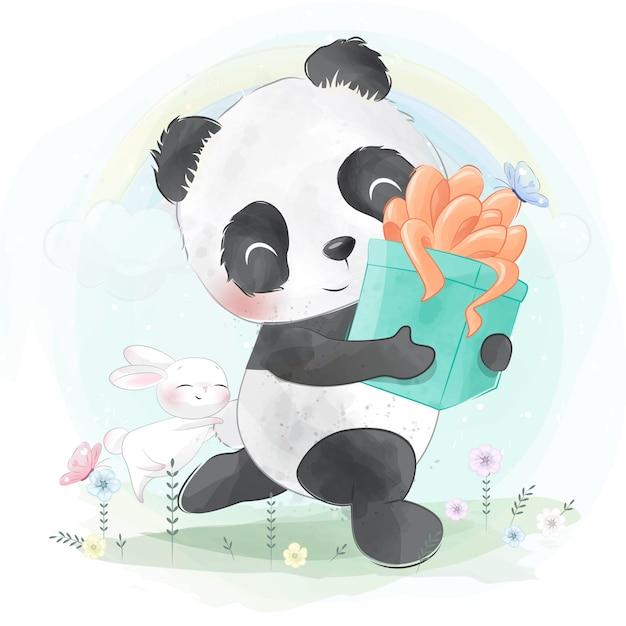 Маленькая панда держит подарочную коробку Premium векторы