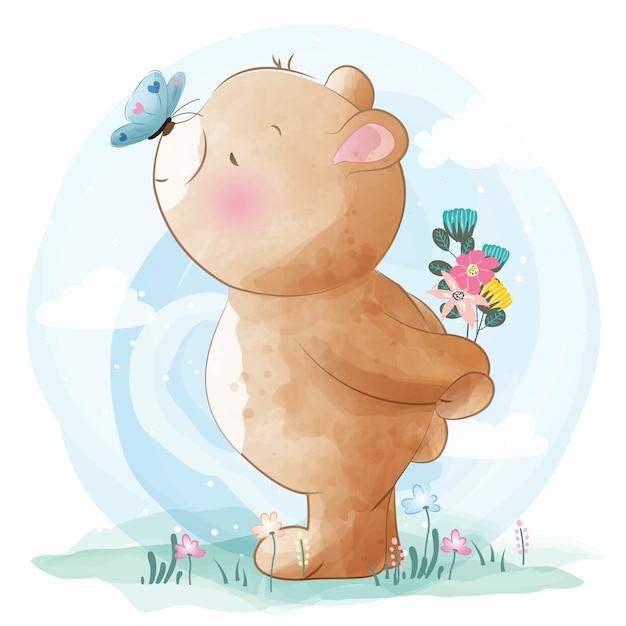 Милый маленький медведь и бабочки Premium векторы