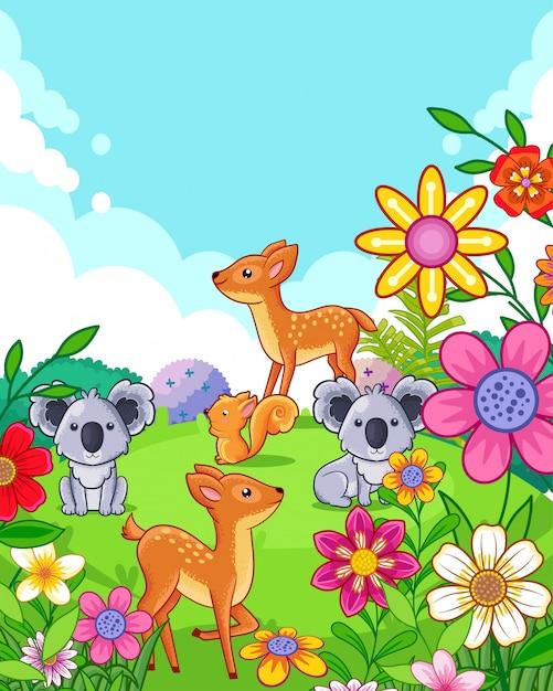 Счастливые милые олени и коалы с цветами играют в саду Premium векторы