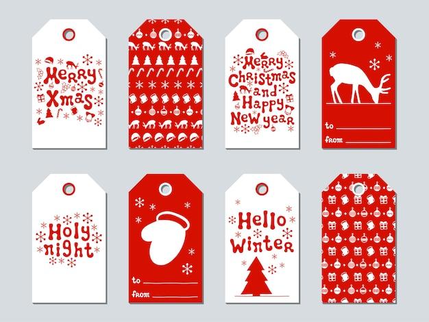 Рождественские и новогодние подарочные бирки Premium векторы