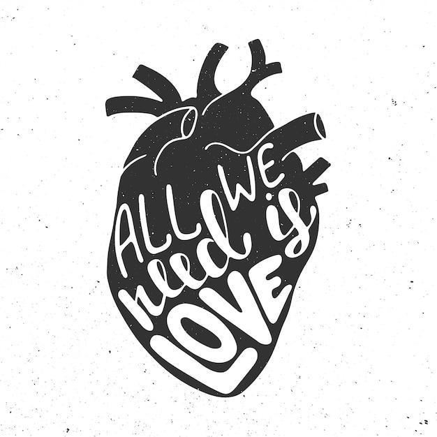 Все, что нам нужно, это любовь в черном анатомическом сердце Premium векторы