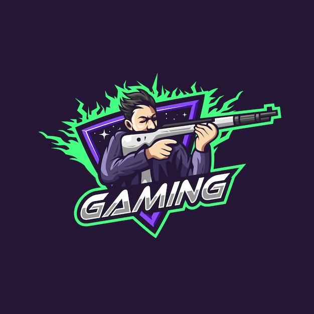 Мужчина держит оружие для игровой команды киберспорт логотип Premium векторы