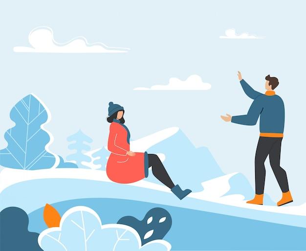 面白い冬時間を屋外で過ごす若い家族 Premiumベクター