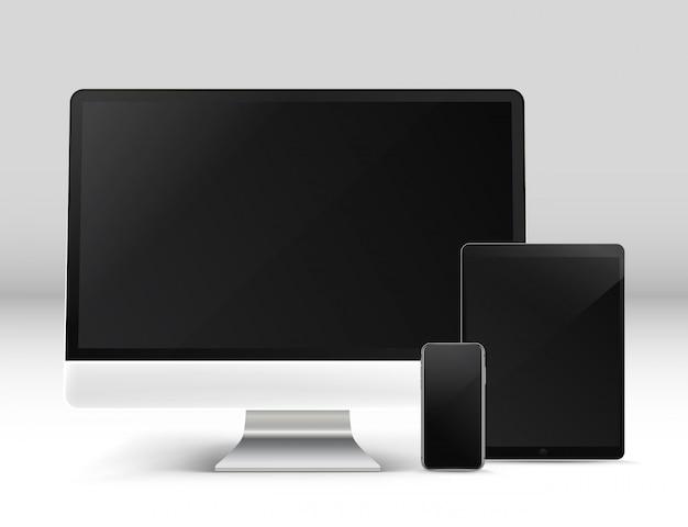 現代のパーソナルコンピュータやテーブルの上の他のガジェット Premiumベクター