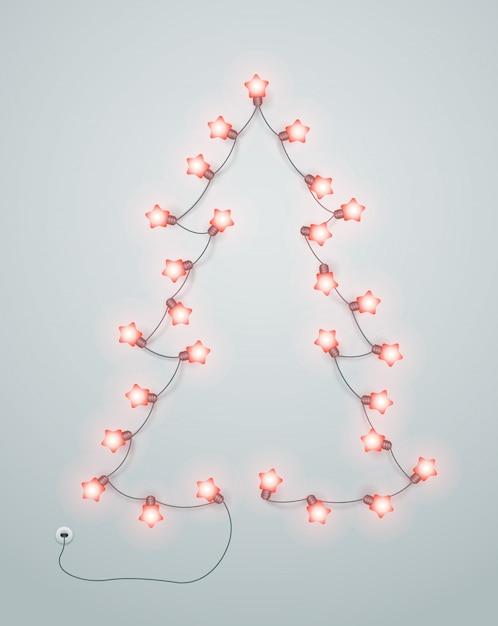 Абстрактная рождественская елка сделанная от гирлянды освещения. Premium векторы