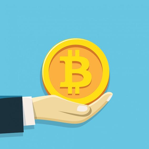 ビットコインのシンボルを持っている手 Premiumベクター