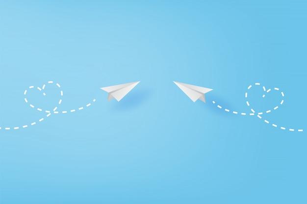 Белые бумажные самолеты летающие концепции сердца Premium векторы