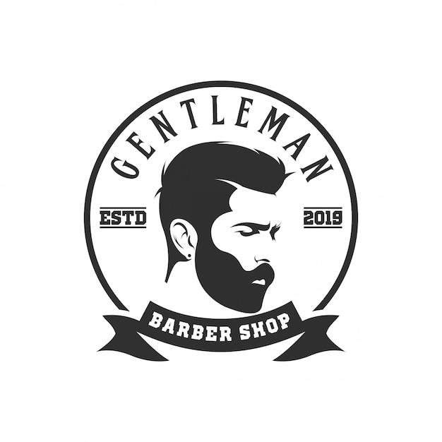 バーバーショップのロゴ Premiumベクター
