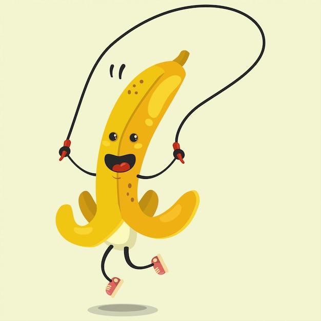 Милый банановый мультипликационный персонаж делает упражнения на скакалке. векторный мультфильм плоской иллюстрации изолированы. здоровое питание и фитнес. Premium векторы