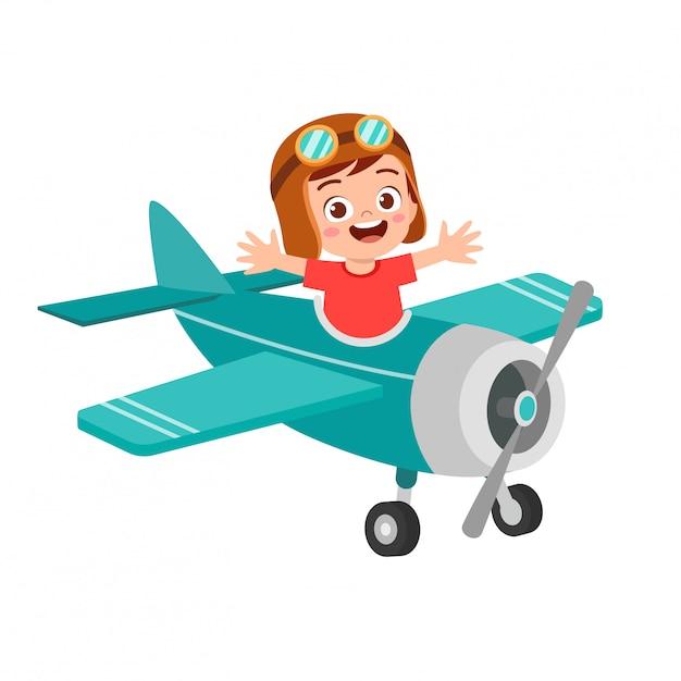 Счастливый мальчик ребенок играть в игрушку летать самолет Premium векторы