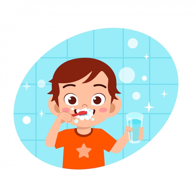 幸せなかわいい男の子のイラストきれいな歯を磨く Premiumベクター