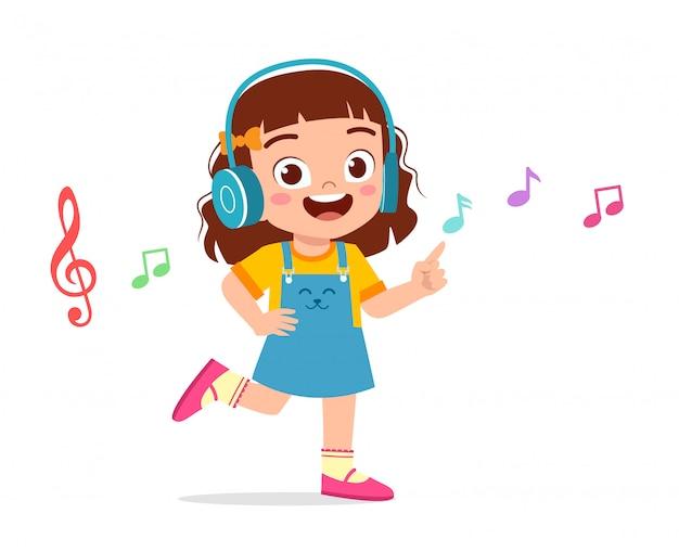 音楽を聴いて幸せなかわいい女の子 Premiumベクター