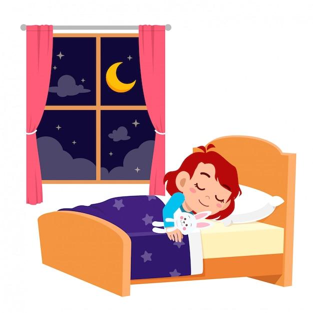 夜に眠る幸せなかわいい子供女の子 Premiumベクター