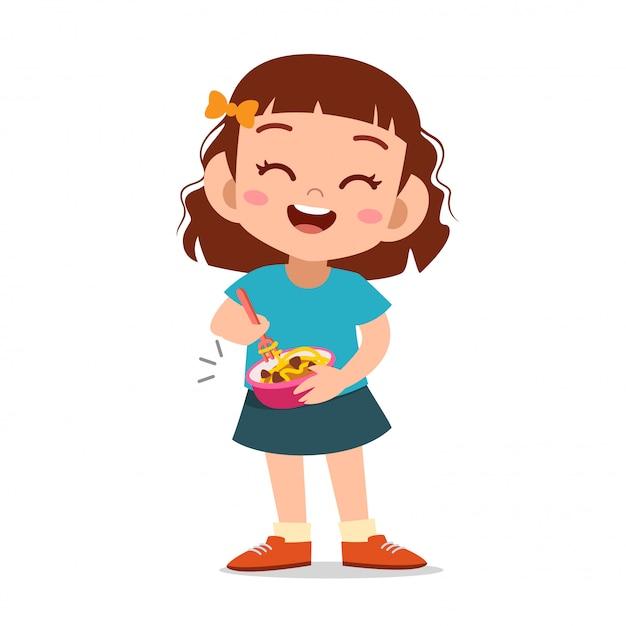 Счастливый малыш ест Premium векторы