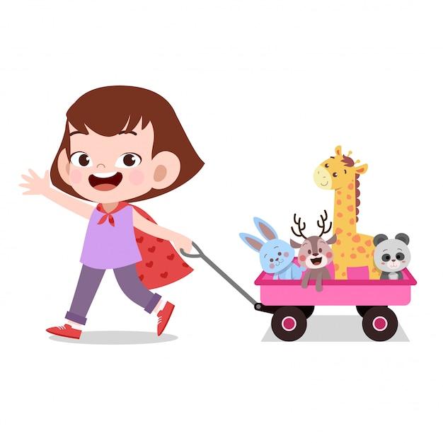 Счастливый малыш девочка, потянув вагон игрушки питомца Premium векторы
