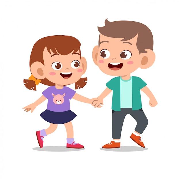 Счастливый милый ребенок играть с другом вместе Premium векторы