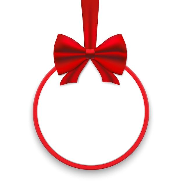 赤いリボンとサテンの弓とクリスマスカード。 Premiumベクター