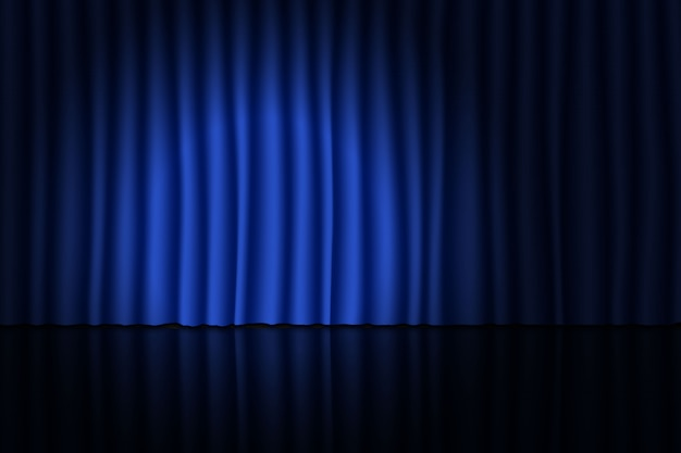 青いカーテンとスポットライトで舞台。 Premiumベクター